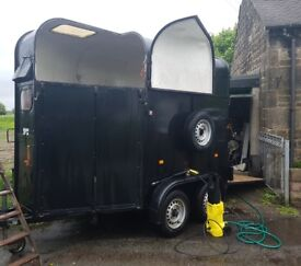 Richardson (rice) horse trailer for sale. Great condition, jockey door, black with white interior.