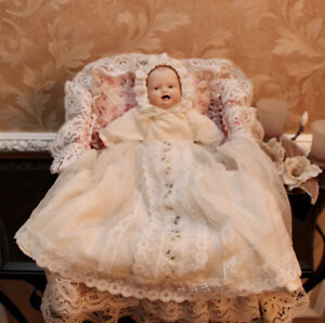 PORCELAIN HAND CRAFTED BABY DOLL WITH BASSINET