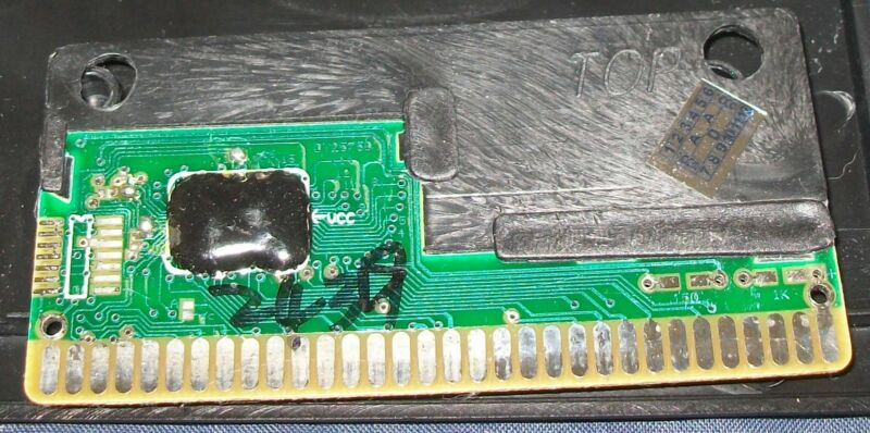 MOST BOOT BOARDS WILL LOOK SOMETHING LIKE THIS, WITH A BLACK BLOB (USUALLY CIRCULAR IN SHAPE) INSTEAD OF A CHIP.