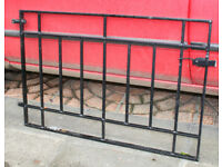 Pair of black iron gates for driveway and single gate for path with posts