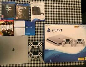 Ps4 500gb limited edition silver, mint condition, and three games