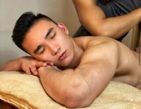 Professional Asian Male Therapist Offering Full Body Massage
