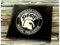 Brand new S.H.A.R.P. wallets.