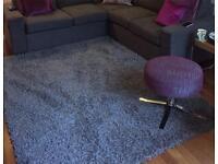 Large grey textured rug