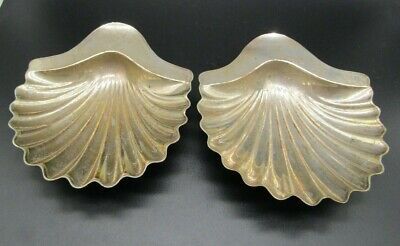 Two white metal scallop dishes, early 20th c