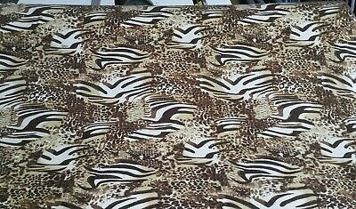 ANIMAL AND GOLD SILVERY PRINT STRETCH SWEATER KNIT JERSEY FABRIC -SOLD BY METER