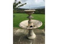 Large stone fountain,table,seats,2 large flower pots,2 med pots, 2 large urns