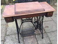 Antique vintage singer sewing machine with cast iron base