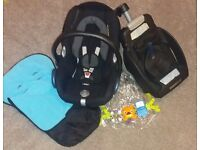 Two Maxi cosi car seats with isofix bases raincovers footmuffs head supports toy bars
