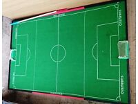 Subbuteo pitch mounted on wooden board and teams