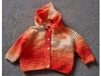Brand new hand knitted cardigan.