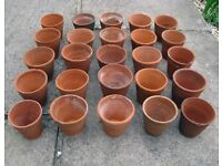 25 Vintage clay terracotta flower pots.
