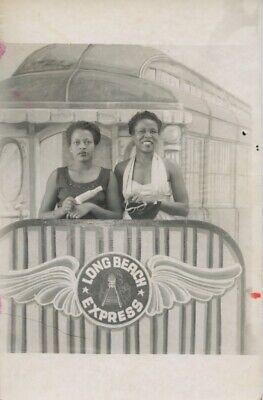 REAL PHOTO POSTCARD.  AFRICAN-AMERICAN WOMEN ON ARCADE LONG BEACH TRAIN.