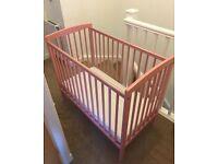Pink space saver cot
