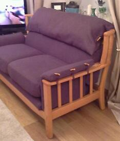 Three seater solid wood framed sofa