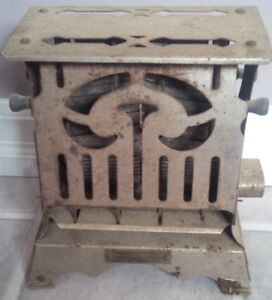 Antique art deco toaster 2 sided, about a century old.