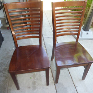 2 pairs of sturdy wooden dining chairs $ 25 per pair