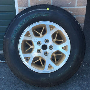 1 Goodyear Eagle LS 225/70R Tire on Gold Jeep Rim