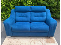A New Large 2 Seater Blue Fabric Material Sofa.