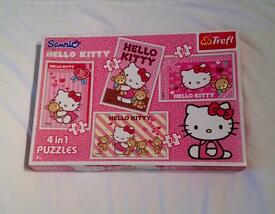 HELLO KITTY 4 IN 1 TWENTY PIECE JIGSAW PUZZLES. COMPLETE AND VERY GOOD CONDITION