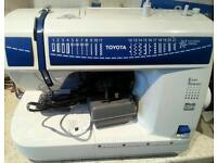 Toyota 21 stitch electric sewing machine complete with foot pedal for sale