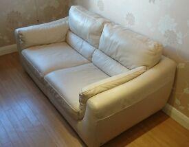 2 seater cream leather Natuzzi sofa in good condition