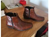 Meet's high heeled cow boys boots. Brand new.