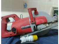 """MILWAUKWEE 7"""" HEAVY DUTY WORM DRIVE GEAR SAW 110 VOLT AS NEW CONDITION."""