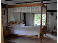 Four poster King size pine bed