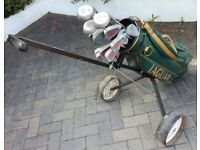 Golf clubs with Jaguar bag and trolley