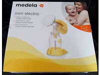 Medela Mini Electric Breastpump. Used twice, with receipt and warranty