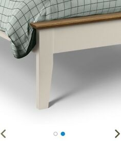 White and wood wooden double bed frame.
