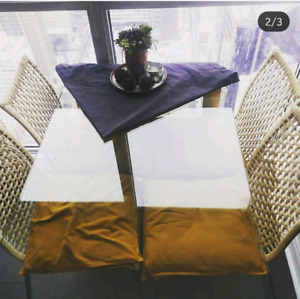 Glass and metal dining table for four