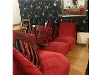 Red velour sofa with cushions