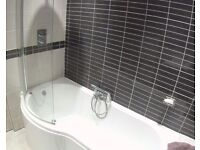 P- shaped white bath and shower screen