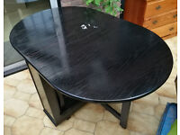 Black Butterfly Fold-Away Dining Table With 4 Chairs For Sale (Used)