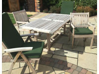 Gloster Teak Table and 4 Chairs(two are reclining, all with arm rests).Top Brand, allweather