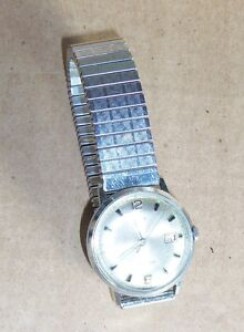 Collectible vintage items: watches, brass sad irons, TI-30