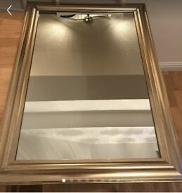 Large gold coloured mirror. Excellent condition.