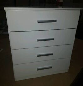 A brand new white gloss finish 4 drawer chest.