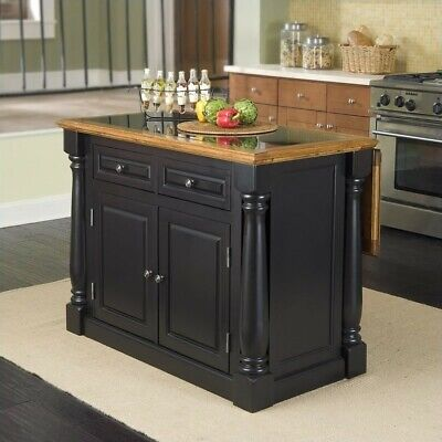 Home Styles Monarch Roll-Out Leg Granite Top Kitchen Island in Black and Oak
