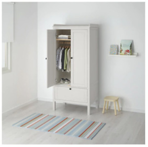 Wood stained white wardrobe