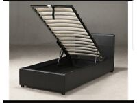 Black leather ottoman bed with storage