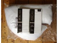 V-shaped pillow and two pillow cases. As new