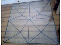 Genuine Alanda metal base glass top coffee table by Paola Piva