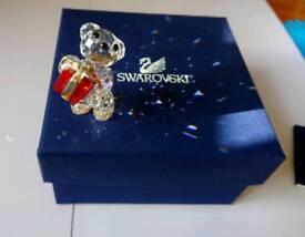 Swarovski bear holding gift/present