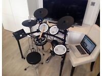 Roland TD25 drum kit with hi-hat stand, pedal, throne, headphone, software, sheet music and MP3s