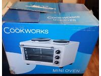 The cook works MINI OVEN with hob
