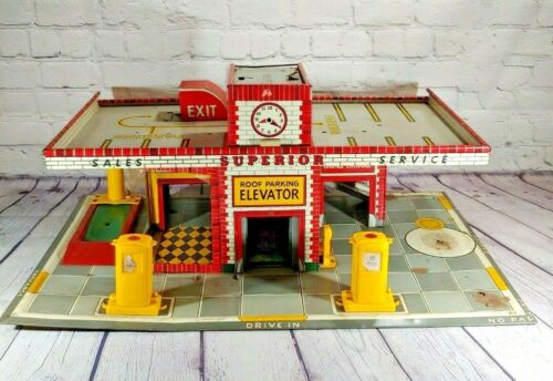 Vintage Superior Roof Parking Elevator Drive-In Tin Toy