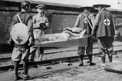 WW2 photo Chinese orderlies with a stretcher at the railway in Shanghai #458